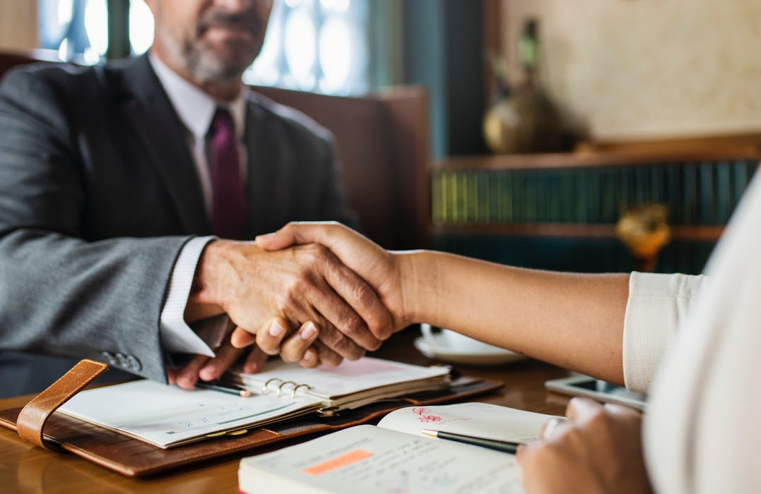 lawyer-client shaking hands