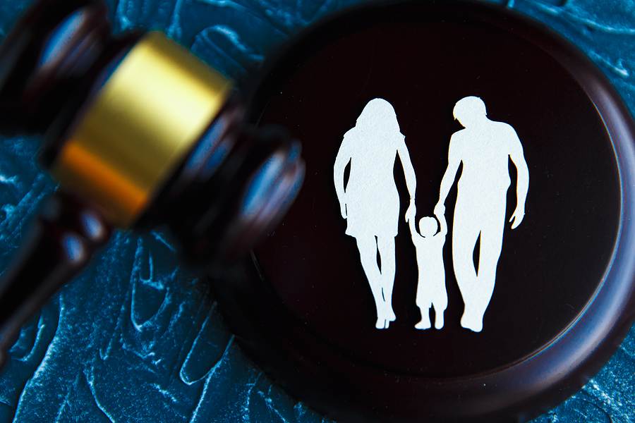Cut out family photo and a gavel, family law concept